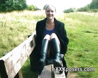Redhead In Boots Flashing Outdoors