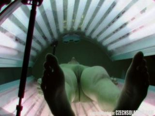 Awesome Brunette Tanning Perfectly Shaved Pussy