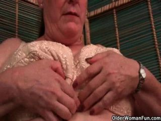 Busty Grandma In Nurse Uniform And Stockings Masturbates