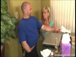 Mature Lady Gloved Handjob
