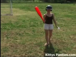 Cute Teen Kitty Playing Baseball Outdoors