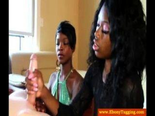 Two Black Ebonies Jerking Dick