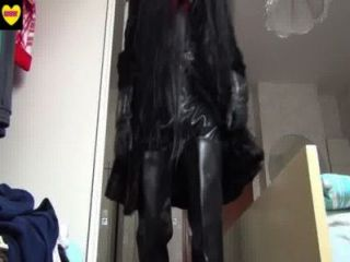 Black Furcoat And Black Rubberwaders