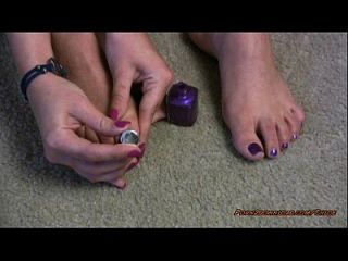 Hot Girl Polishing Her Toe Nails