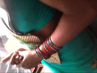 Slim Bhabhi Showing Her Navel N Boob Curves Secretly