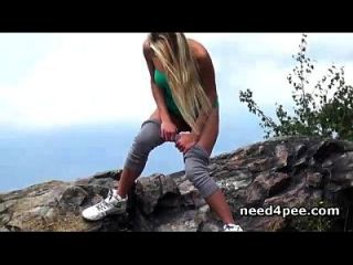 Sporty Blonde Gets Down For A Piss On The Rocks