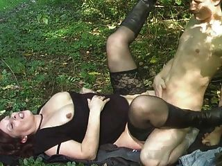 Mature Baby With A Young Boy In The Forest