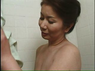Mature Asian Lady Bathes Young Man