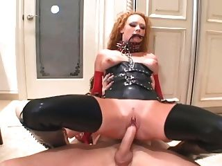 Redhead Anal In Boots A Corset And Latex Gloves