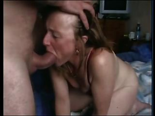 Busty grandma sucks cock
