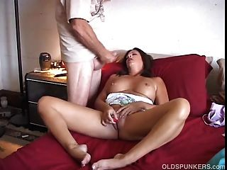 Sexy Older Babe Has A Wank While Some Guy Cums On Her Tits