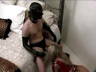 Latex Slave Dominates A Whore