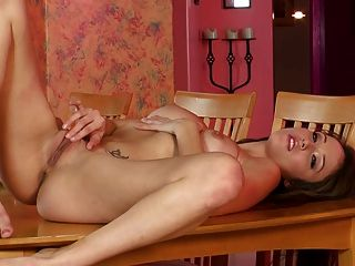 Brunette Squirts On The Table