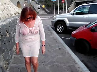 Beautiful Mature Slut Walks Around The City With Naked Boobs