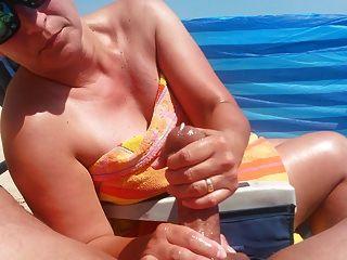 Handjob On The Beach With Big Cumshot By Hot Milf