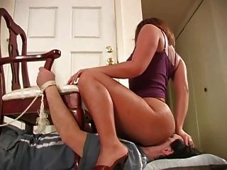 Bound To Chair And Facesat By Hot Brunette