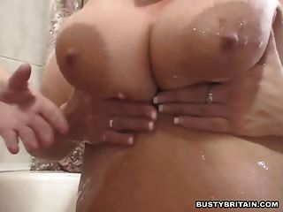 Two Big Tits Lesbians Have Fun In A Bath