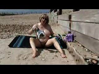 Older Slut Masturbating On A Beach !
