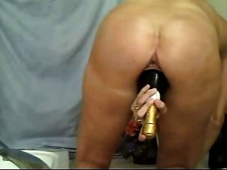 Mature And A Bottle In The Pussy