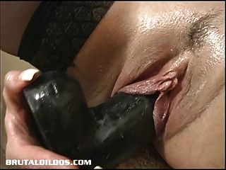 Tatiana Inserting Brutal Dildo