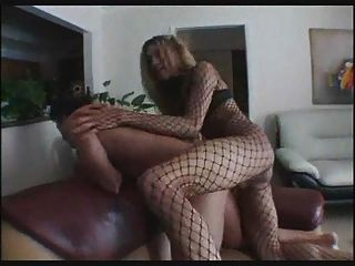 Tranny In Fishnet Handles Two Rods