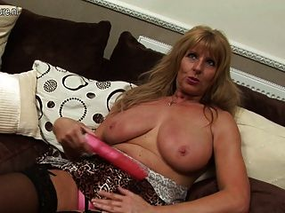 Hot Grandma Stuffing Her Pussy With A Dildo