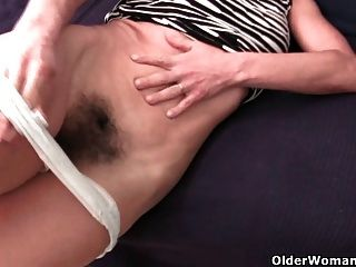 Granny In Soaked Panties Fingering Hairy And Swollen Cunt