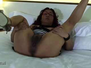 Mature Mom Zizi Plays With Her Toys