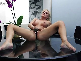 Hot Milf Masturbating On Her Glass Table