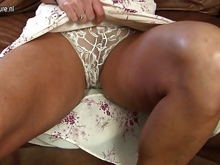 Amateur British Mom Playing On Her Couch