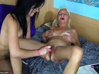 Lesbea Young Girl Wears a Big Strap on Dildo to