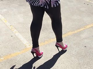 Walking In Wetook Leggings And Pink Heels