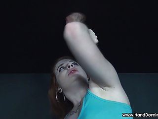 Redhead Gives Handjob To Gloryhole Dick