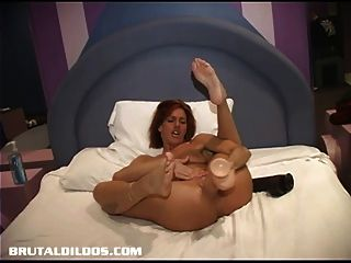 Amateur Fucking A Big Brutal Dildo In Bed