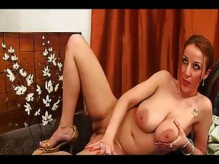 German Brenda Plays With Her Big Tits And Big White Dildo