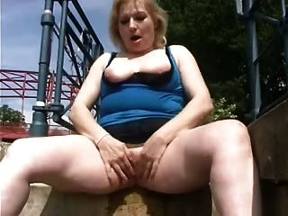 Exhibition Outdoor Of A Cute Granny. Amateur Older
