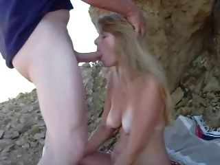 Swallowing Cock On A Beach