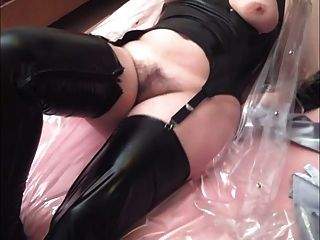 Crossdresser Playing With Wife In Plastic And Pvc