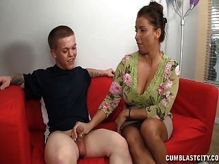 A Busty Milf Gets Cumblasted Jerking A Short Guy