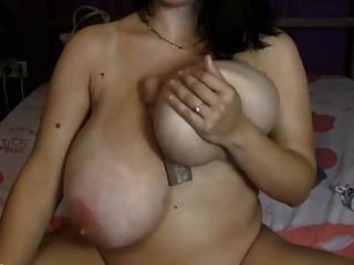 Brunette With Huge Melons Plays Rides Toy