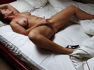 Beautiful Mature Woman Masturbating In Bed