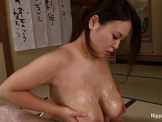 Japanese Hottie Gets A Cock Between Her Enormous Tits