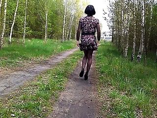 Crossdresser In Sexy Outfit & Walking In Forest Near A Road