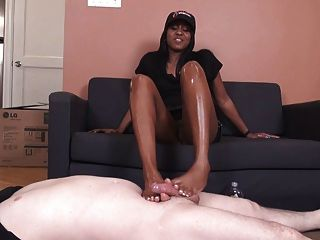 Ebony Footjob On White Cock