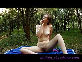 Naked Smoking With Toys In The Woods- Andrea Sky