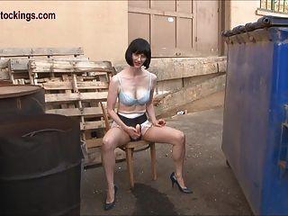 Mature Lady Masturbates Outside While Stroking Her Strapon