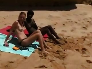 Black And White Girl Share A Cock On The Beach !!!