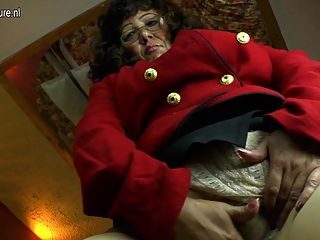 Mature mom plays with her swollen pussy