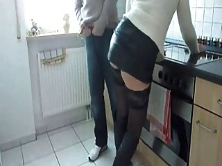 German Couple In The Kitchen