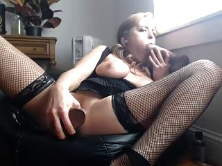 Cam Model Dps Herself With Large Black Dildos